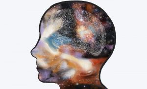 Drawing of a silhouette of a head with the galaxy inside.